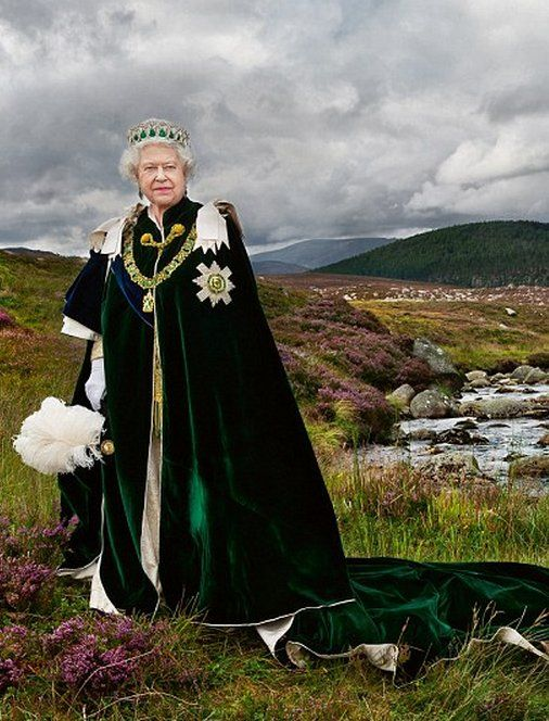 NEW OFFICIAL PORTRAIT OF THE QUEEN   Queen Elizabeth II of the United Kingdom (born 1926) wears the Vladimir Tiara with the Cambridge emerald drops. The portrait, which is featured in a new edition of Keepers of the Kingdom, depicts the monarch wearing the robes of the Most Ancient and Most Noble Order of the Thistle, the most senior order of Scottish chivalry.: