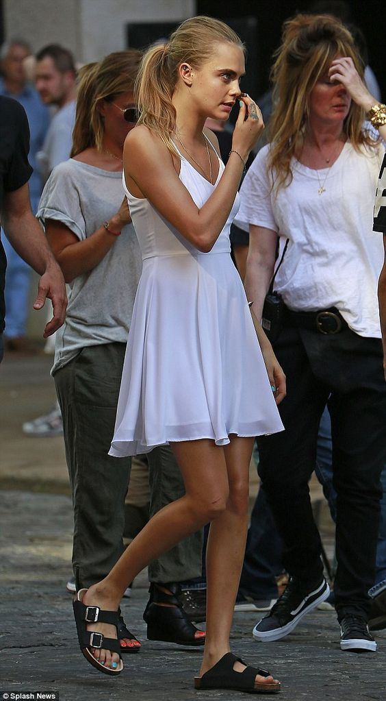 Stepping out: Cara Delevingne sported a seasonal white summer dress for a photo-shoot in New York City on Thursday evening