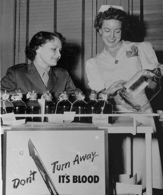 Female US Marine Sergeant Doris Hayes and nurse Alice Horton at a blood donation drive, United States, circa 1945. (US Marine Corps photo)