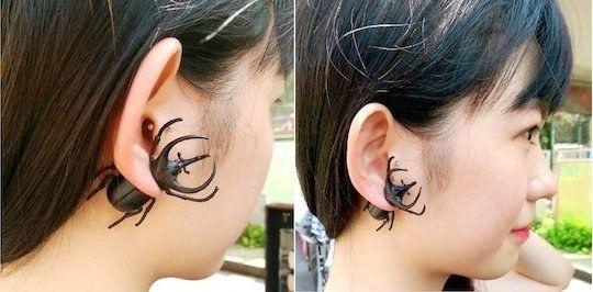 This rhinoceros beetle earring.
