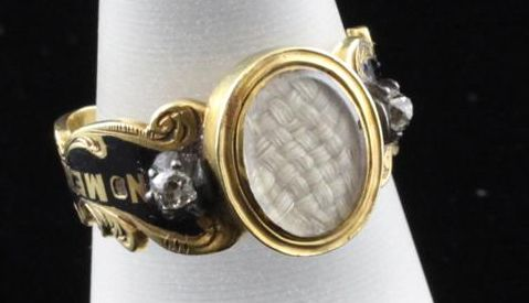 18K gold ring of enamel, diamond, and woven hair under glass. Motto around band says: In Memory of My Brother. English, 1855
