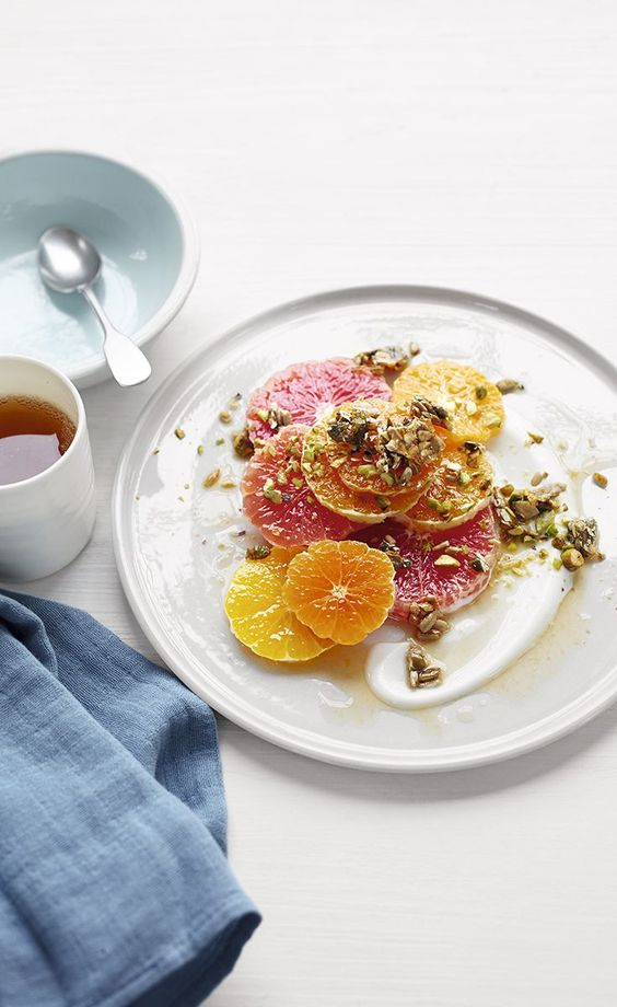 This tangy citrus salad scattered with pistachios, pumpkin and sunflower seeds is a delicious healthy breakfast recipe - packed with vitamin C and one of your five a day.