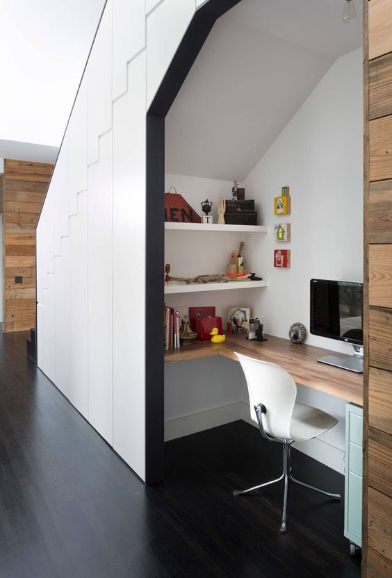 Small Home Office Idea - Make use of a small space and tuck your desk away in an alcove // This desk tucked under the stairs features a wrap around desk, two wall mounted shelves, and a small filing cabinet. All the essentials you need for a functional home office.