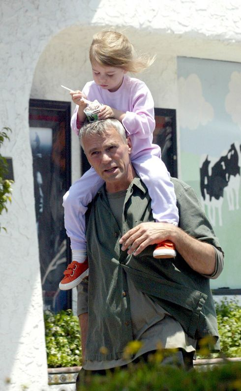 RDA with daughter Wylie eating ice cream off of his head....too cute