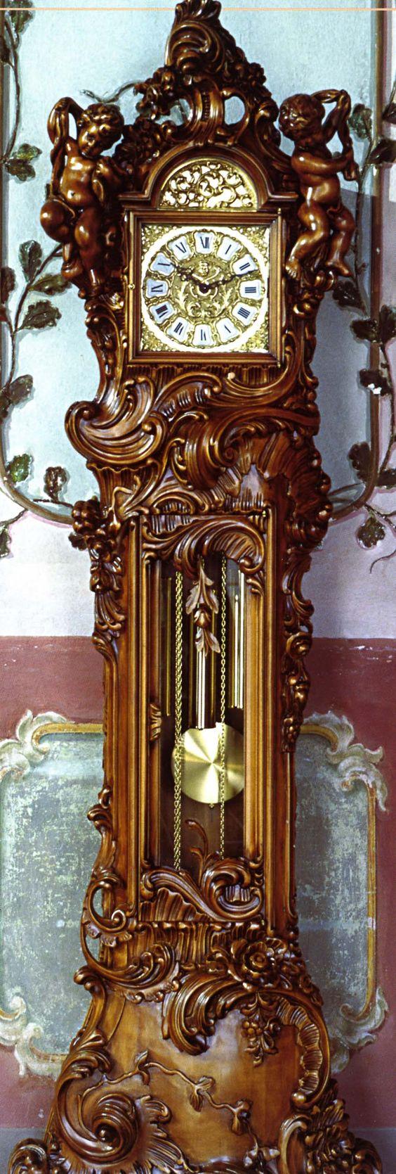 Ornately carved Le Ore grandfather clock. (Italian)