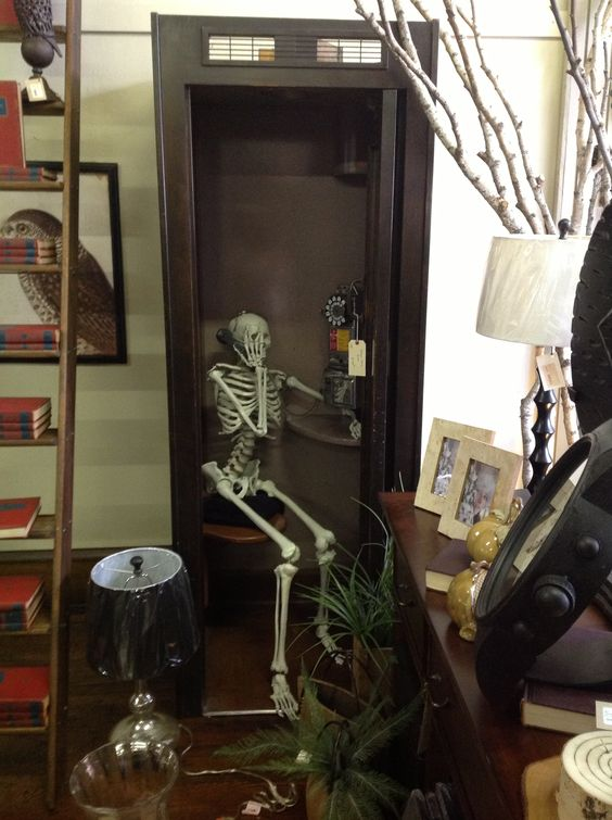 Skelton in an old phone booth!