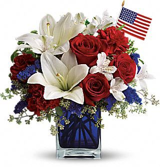 America the Beautiful by Teleflora  A patriotic pick to send a brave veteran, decorate your Fourth of July picnic, or celebrate Memorial Day. Lush red, white and blue flowers are presented in a deep blue glass cube vase along with an American flag.