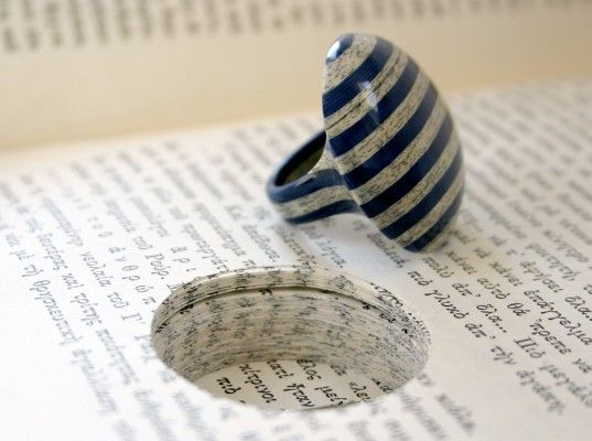Jeremy Mays makes literary jewelry from cross-sections of old books.