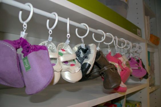 Can't find anything in your baby's closet? Use a rod and shower curtain clips to organize your baby shoes! #Nesting