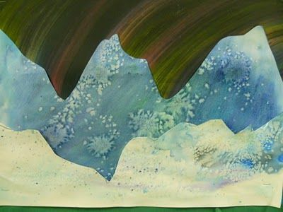 Aurora borealis art using salt & watercolor papers, scraped paint papers - collaged in layers. Try adding a cut paper polar bear or penguin. Use as interdisciplinary teaching with science or geography!