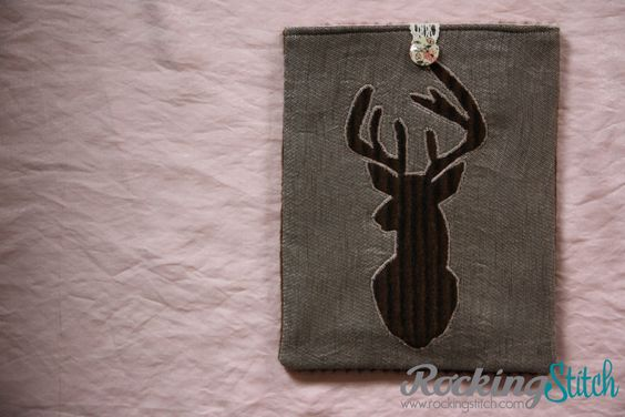 iPad sleeve with a Stag Head - iPad cover fake fur applique - Lined with a pink fabric.