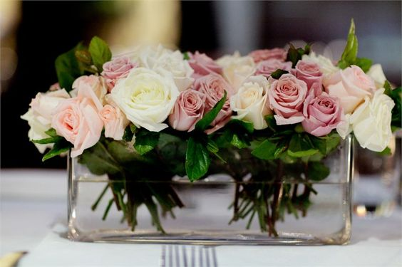 Dusky pink, cream and white roses, perfect for a vintage wedding centrepieces from Dusty Miller Designs