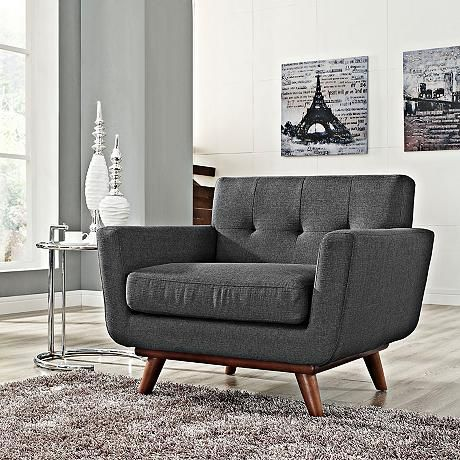 Beautiful button tufting enhances the look of this soft gray fabric modern armchair.