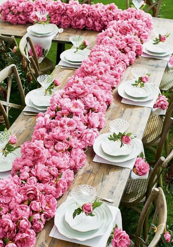 Forget a peony flower arch, THIS table runner of pink peonies is how to feature peonies at your wedding!! Use these 15 Of The Prettiest Pink Peonies For Your Wedding • Wedding Ideas magazine