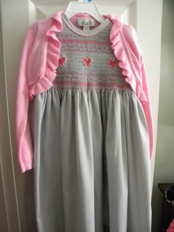 Hopefully the (purchased) sweater will take the dress into quickly approaching fall!  Stitched around the edge of the ruffle with gray and pink floss.