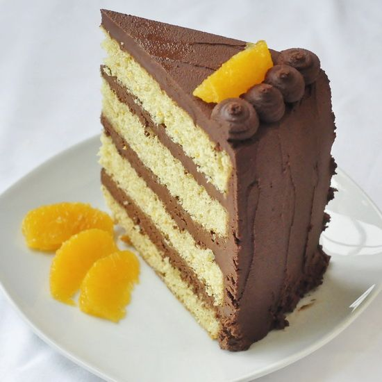 Orange Cake with Chocolate Truffle Frosting - a real, old-fashioned orange scratch cake with an easy to make, melt-in-your-mouth chocolate truffle frosting.