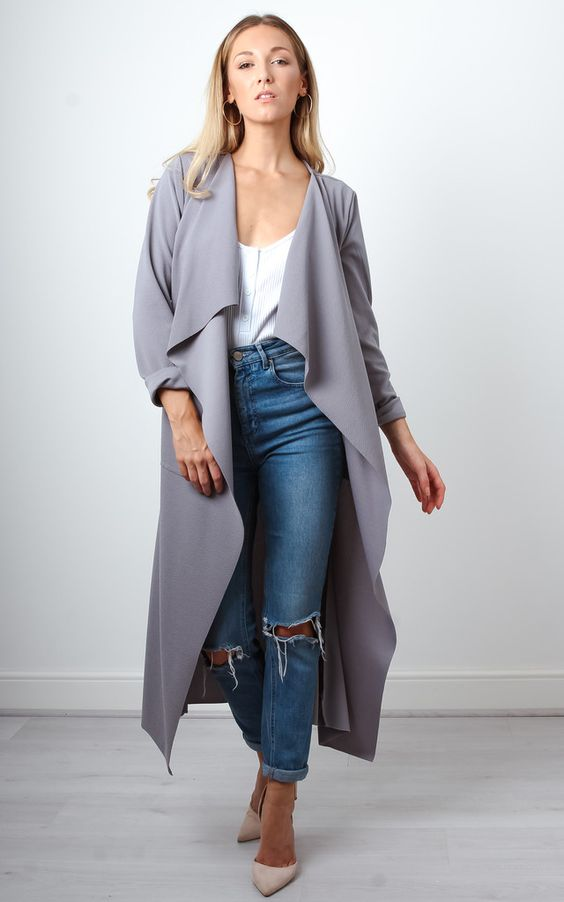 In a gorgeous shade of grey, this versatile waterfall duster coat is a great winter coat choice. The duster coat style looks great with any look and keeps you warm top from bottom.