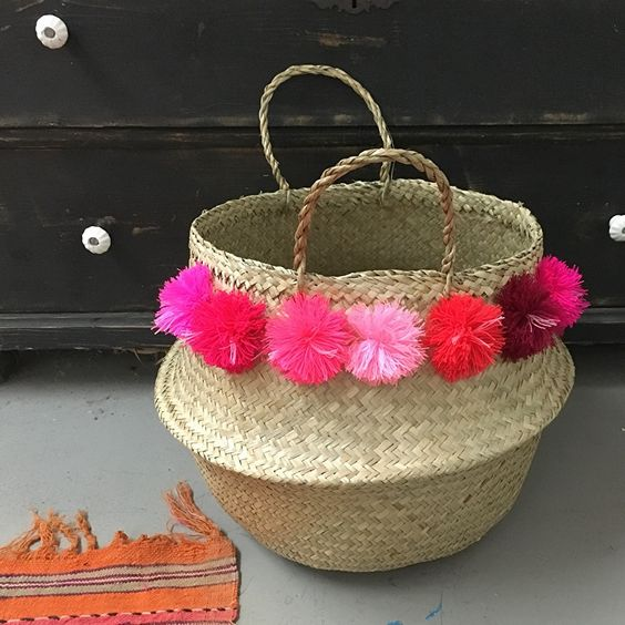 """handmade basket with 14 special red and pink pom pomsapproximately 14"""" tall not including handlePlease order by February 10th in order to receive by Valentine's DayFor international orders please email hello@elizagranstudio.com"""