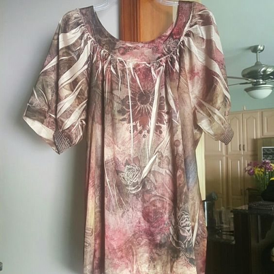 Lane bryant blouse Beautiful design in the shirt and the sleeves have an elastic bottom. Size 22/24 Lane Bryant Tops Blouses