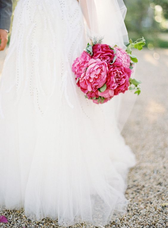 Romantic tulle wedding dress and peony bouquet via Style Me Pretty. Wedding dress by Monique Lhuillier; floral design by Kathleen Deery Design; photo by Jose Villa Photography.