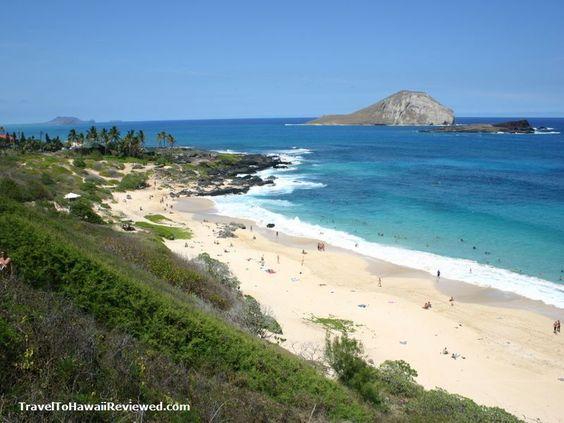 Makapu'u Beach, Oahu, Hawaii: Great body surfing, but islands in the bay are shark breeding grounds. Careful - Sharp coral reefs beside swimming beach.
