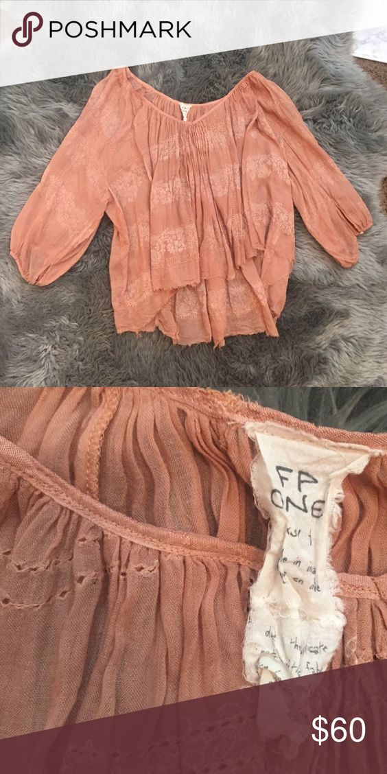 Peasant style free people top This soft pinky peach blouse can be worn day or night and had a cream floral print on it! Free People Tops Blouses