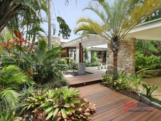 Like this tropical entrance to a home tropical paths for Balinese garden design