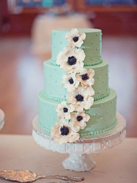 mint green wedding cake with white anemones by dana
