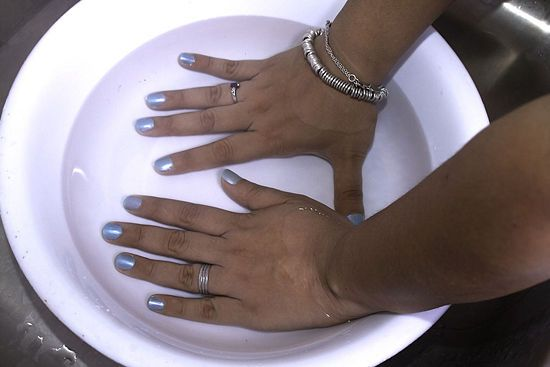 Submerge wet nails in cold water for 3 minutes. The polish will dry completely, and it gets rid of any that got onto your skin! This is life-changing.
