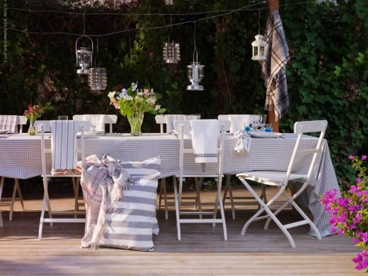 Simple outdoor entertaining.  Hang blankets for a rustic look :  )