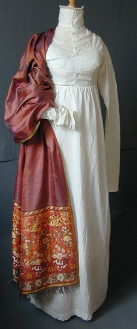 High-necked white cotton sport under gown, English, c. 1800. This would have been worn under a heavier dress, redingote or a riding habit, when a high neck would be needed. The cutaway front would have allowed flexibility while moving the arms, playing archery, or other country pursuits. The buttoning is masculine, left over right, indicating this was worn for outside sporting wear.