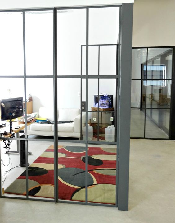 View of the corner office with the custom, steel, true divided ...
