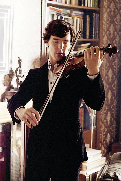 Sherlock and his violin.  Love.