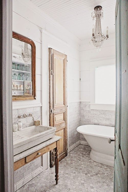 French farmhouse style bathroom with rustic antique details and design by Dreamy Whites. Come check out Antique Vintage Style Bathroom Vanity Inspiration! #bathroomdesign #bathroomvanity #classicstyle #traditionaldecor #interiordesignideas