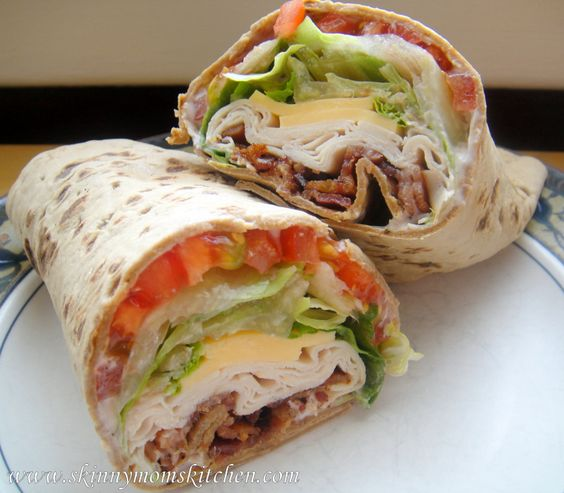 Skinny Turkey Ranch Club Wrap.  1 Flatout Wrap   2 ounce of smoked turkey   1/2 slice sharp american cheese  2 slices cooked bacon**   1 tablespoon Ranch yogurt dressing   2 tomato slices  Romaine lettuce