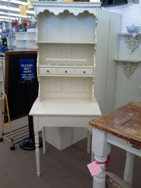 SOLD - Secretary desk with hutch top, one drawer and lift of writing surface for hidden storage - one piece construction - Painted creamy white, distressed and finished with a tinted wax. ***** In Booth E6 at Main Street Antique Mall 7260 E Main St (east of Power RD on MAIN STREET) Mesa Az 85207 **** Open 7 days a week 10:00AM-5:30PM **** Call for more information 480 924 1122 **** We Accept cash, debit, VISA, Mastercard, Discover or American Express