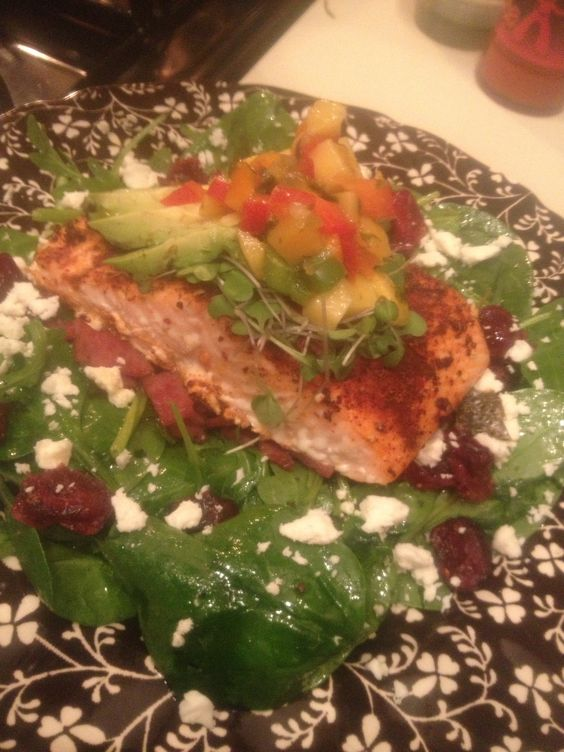 ... , topped with micro greens, avocado and mango pineapple chili salsa