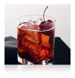 Grey Goose Black Cherry Cola cocktail - Grey Goose Cherry Noir Vodka, Cola, Grenadine, fresh cherry garnish.