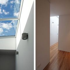 Skylight to maximise light on joint wall. Above stairs?