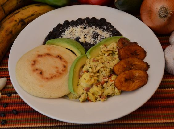 """Desayuno Venezolano"" - Perico, which is a scramble of eggs and minced veggies; black beans, avocadoes, and plantains."