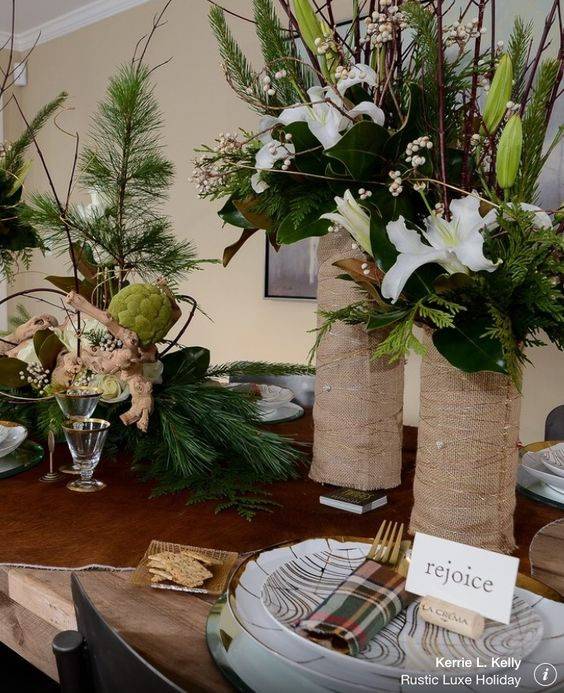 Love the vases covered in burlap, with white lilies....perfect for casual Christmas.
