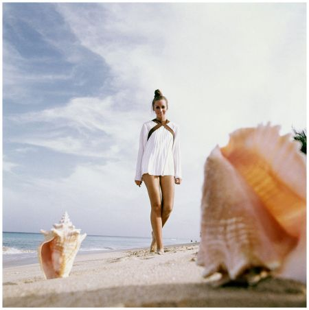 Model in White Pleated Tunic at Beach Barbados beach with conch shells in foreground, 1969 Condè Nast Archive Photo Arnaud de Rosnay