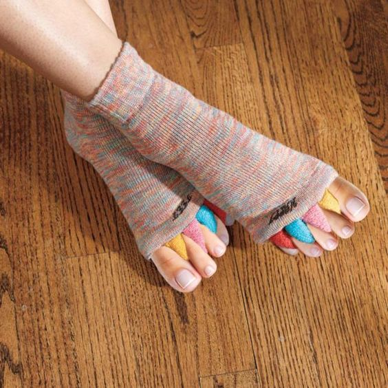 Relief for bunions, hammer toes, cramps...and even tired feet. These gentle foot alignment socks are one of the smartest ways to prevent and alleviate foot aches and pain. Soft, fluffy fabric hugs your feet and aligns your toes for instant relief.