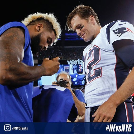 @iam_objxiii signs his jersey for Tom Brady after tonight's game.