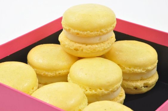 Lemon Curd Macarons - French lemon macarons are light and tender meringue-based cookies filled with sweet and tart lemon curd. Recipe by @Eddy Van Damme