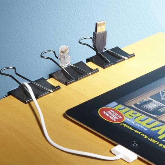 Clamp a binder clip to the edge of your desk to holster USB cables. No more cables slipping behind your desk into the dusty darkness below.