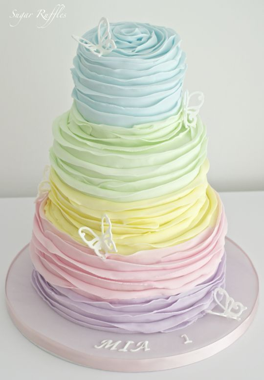 Rainbow Ruffle Cake by Sugar Ruffles. Try it with buttercream and pull out each layer with a large petal tip.