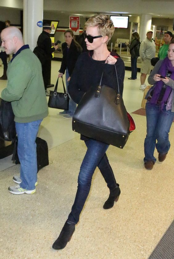 Charlize Theron at Logan Airport, March 16th