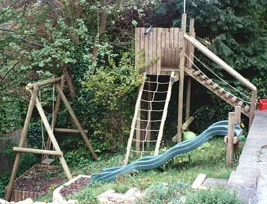 Wooden play equipment swings forts scramble nets for Wooden swing set with bridge