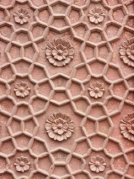 Pattern-Carved-in-Sandstone-via-123RF-stock-photo